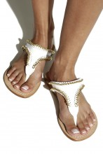 White sandals with gold chain trim